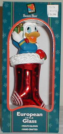 This Is A 75 Blown Glass Christmas Ornament Showing Donald Duck Perched Inside Of Large Shiny Red Stocking With White Trim
