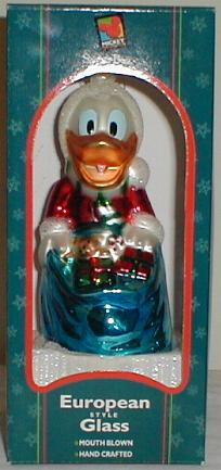 This Is A 65 Blown Glass Christmas Ornament Showing Donald Duck As Santa Claus With Large Overflowing Blue Sack Of Gifts In Front Him