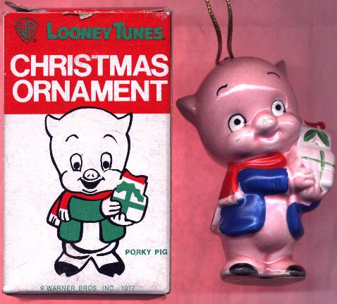this is a 325 ceramic christmas ornament showing porky pig holding two white and green christmas gifts by his left shoulder he wears a blue jacket and a - Porky Pig Blue Christmas