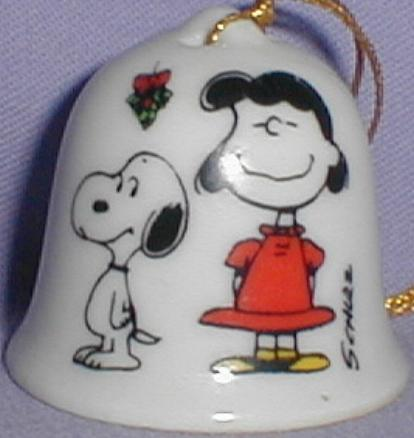This Is A 1 75 Ceramic Bell Shaped Christmas Ornament Showing Snoopy And Lucy Standing Beneath A Sprig Of Mistletoe Lucy Wears A Red Dress And Yellow